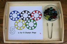 Activity: Use pom-poms to complete the five Olympic rings.  You will need: Olympic ring print-out and multi-colored pom-poms. If necessary, follow this link for further directions or alternate material instruction.