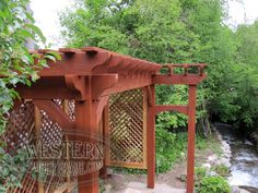 Free standing pergola with Rich Sequoia stain and Roosevelt profile. Upgraded lattice walls and extended trellis entryway attached on side.