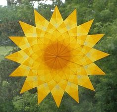 Yellow Mandala Floral Window Star - Waldorf Sun Catcher. Of course, I love these too Mal.