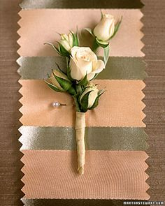 A boutonniere of five minispray rosebuds is contained in a spiral of pale-peach silk.