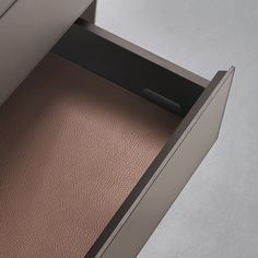 """Self Up"" Aluminium drawer by Rimadesio.   Brown aluminium structure and matt lacquered caffè glass front."