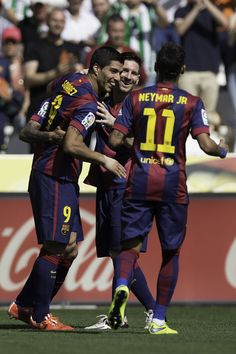 Luis Suarez (L) of FC Barcelona celebrates scoring their fourth goal with teammates Neymar JR. (R) and Lionel Messi (2ndL) during the La Liga match between Cordoba CF and Barcelona FC at El Arcangel stadium on May 2, 2015 in Cordoba, Spain.