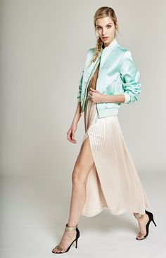Grenn mint Bomber Jacket combined with a pleated ivory skirt! Details do matter and when it comes to our brand, details make the difference!! #fashion #fashionlabel #fashionphotography #fashionindustry #fashionstyle #fashionforwomen #bomberjacket #silkbomberjacket #pleatedskirt #ivoryskirt #details #oanapop #fashiondesigner