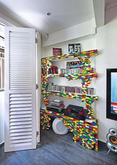 Legos + imagination = one of a kind bookshelves! (They're affixed to the front!) #diy