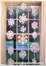 I love the paper snowflake curtains that are proudly displayed on Pinterest. Supposedly, they are really easy to make! There are lots of tut...