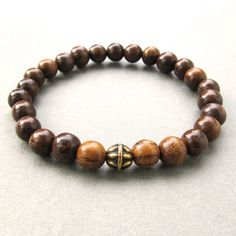 Mens brown robles wooden beaded stretch bracelet with antique gold bead by lowusu on Etsy https://www.etsy.com/listing/112292331/mens-brown-robles-wooden-beaded-stretch