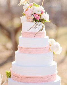 Are you tickled pink by this simple white and pink cake? See even more of this Coral and Mint Wedding that is totally adorable captured by Amanda Jameson with cake by Fancy Cakes By Lauren.