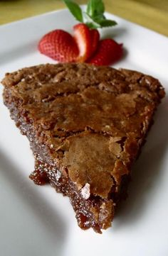 "4 ounces unsalted butter, with a bit extra for greasing pie plate  1 ½ squares unsweetened baking chocolate (1.5 ounces)  1 cup sugar  2 eggs, beaten  1 teaspoon vanilla extract  ¼ cup AP flour (that is ""all-purpose"" for those of you not yet hip to food jive…)  2 tablespoons milk"
