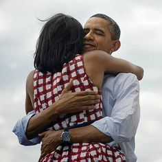 President Barack Obama embraces wife Michelle