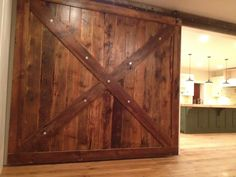 9 x 9 Sliding barn door by Timberguy. Bedford MA. Made from the floorboards of an old Ice House