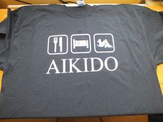 Black gildan t shirt with eat sleep aikido on front, XL and L