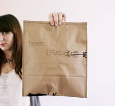 Sew an envelope for shipping goodies using a paper bag