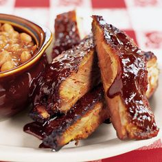 Kansas City Sticky Ribs are slow-smoked pork ribs slathered in a sauce so thick, sweet, and sticky that you need a case of wet naps to get your hands clean after eating them.