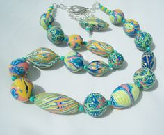 out to sea   Wonderful polymer clay necklace with beautiful colors by Carol BEal