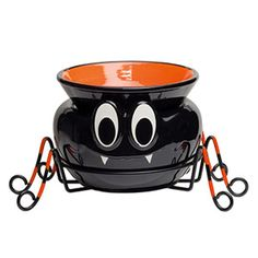 Itsy Bitsy spins a whimsical web of Halloween fun. This three-piece Element Warmer consists of a warmer base and dish that rest on metal legs.