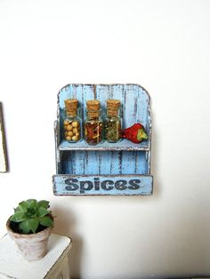 Dollhouse miniature shelf dollhouse rack 3 spice by DewdropMinis Handmade Market, Etsy Handmade, Wall Shelves, Shelf, Spice Labels, Garden Accessories, Dollhouse Furniture, Vintage Dolls, Glass Jars
