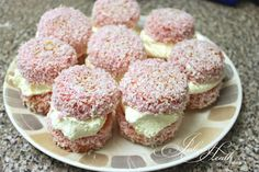Australian Jelly Cakes with Cream. The best! Dip cupcakes into unset Strawberry jelly then roll in coconut and fill with cream
