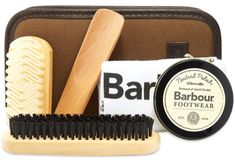 Barbour leather shoe care kit compromising Barbour bag inside which can be found 1x neutral shoe cream, 1x suede brush, 1x polishing brush, 1x wooden shoe horn, 1x soft lint free cloth.  To keep your leather shoes tip top apply a conditioning crème with a soft cloth. This will prevent your footwear from drying out or cracking and will help to maintain original finish. Made in the UK.