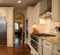 Off white cabinets - I have the same countertops, thinking about doing this to my kitchen...