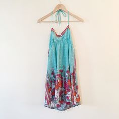 O'Neill   Teal floral halter dress Perfect for beach cover up or fun summer dress. Halter top ties. This dress was worn once and is in perfect condition. Lined • 11026 • O'Neill Dresses