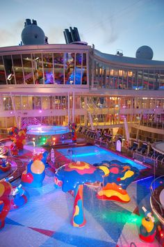 Pools at dusk on Royal Caribbean's Oasis of the Seas - Family Time... Sure hope Wyatt and Ellis likes this cruise. We can't wait till vacation gets here!