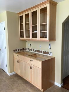 Part Of A Kitchen In Natural Maple, Shaker Style And Routed For Glass.  Cabinets