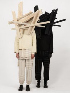 London designer Craig Green fashioned masks from splintered planks of wood for his Autumn Winter 2013 collection.