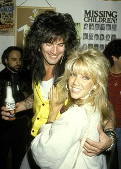 '80s power couple. They must have spent a fortune on hair products.