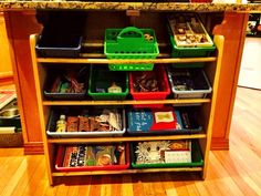 Toy storage shelving = perfect indoor arts & craft storage. Fits right under kitchen island (with kids table in breakfast area).
