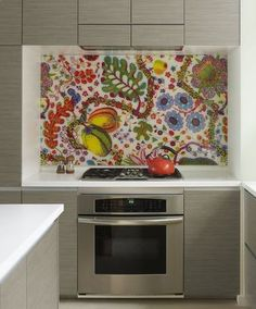 What a great idea.  Select fabric and cover with glass for stove backsplash.  houzz.com