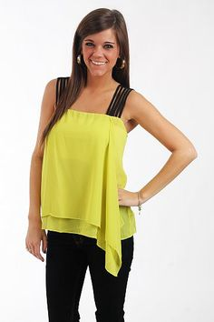 """Bright Now Top, Lime $37.00  We are crazy about this tank! The bright color is right on trend for this season and we cannot get enough of the multiple skinny black straps. Did you see how fabric gathers and hangs a little longer on one side? So cute!   Fits true to size. Miranda is wearing a small.   From shoulder to hem:  Small - 21""""  Medium - 22""""  Large - 23"""""""
