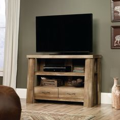 The Boone Mountain TV Stand from Sauder Woodworking Co. comes in a sandy brown craftsman oak finish on sturdy log cabin construction. Features 2 drawers with handle pulls and divided shelving with open backs for storage, display, and electronics. Cabin Furniture, Pallet Furniture, Rustic Furniture, Living Room Furniture, Antique Furniture, Outdoor Furniture, Furniture Stores, Luxury Furniture, Furniture Ideas