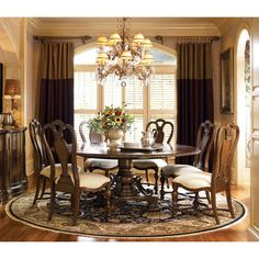 Universal Furniture Bolero Seville 7 piece Dining Set - With its elegant round dining table and handsome chairs, the Bolero Seville 7 pc. Dining Set is a stylish way to dine. This set includes a pedesta...