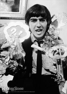 George Harrison celebrating his 21st birthday