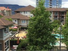Live the pedestrian lifestyle in downtown Kelowna! This FANTASTIC open concept, 2 bedroom split plan has a lake view & a great location in the building