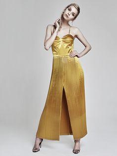 Metallic pleated dress by Oana Pop! Photo: Zoltan Mihaly Model: Cristina Oltean Mua: Ioana Malai Hair: Leve Iuhos