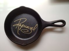 In Disneyworld, have Rapunzel sign a frying pan. I would seriously put this in my kitchen. This needs to happen.