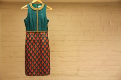 Raw silk dress in turquoise and coral with gold nakshi hand embroidery by Vijay Balhara on Indianroots.com