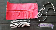 "The outer part is for all of your make-up brushes and tubes. It measures 11"" wide.  It can be rolled up and tied on it's own or around the little bag.  There are 9 slots for your brushes or tubes. Zebra makeup bag. Makeup storage. Fold up makeup bag. Roll up makeup bag. Just $10 at Jourdan's Jewels. Pink zebra. Pink zebra print."