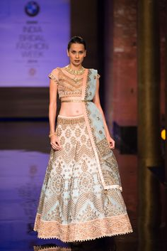 Pink and coral blue lehnga by JJ Valaya at India Bridal Fashion Week. More here: http://www.indianweddingsite.com/bmw-india-bridal-fashion-week-ibfw-2014-jj-valaya/