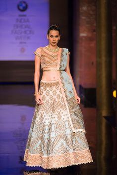 Pink and coral blue lehnga by JJ Valaya at India Bridal Fashion Week. More here: http://www.indianweddingsite.com/bmw-india-bridal-fashion-week-ibfw-2014-jj-valaya/