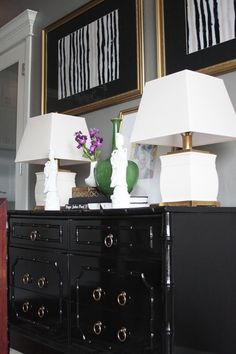 glossy black bamboo dresser w/ gold pulls.  white pair of lamps.  love it all! (Little Green Notebook: Room Tours: Callie's Home)
