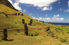 Rano Raraku, Easter Island is a volcanic crater formed of consolidated volcanic ash, or tuff, and located on the lower slopes of Terevaka in the Rapa Nui National Park on Easter Island. It was a quarry for about 500 years until the early eighteenth century, and supplied the stone from which about 95% of the island's known monolithic sculptures (moai) were carved. Rano Raraku is a visual record of moai design vocabulary and technological innovation, where 397 moai remain.