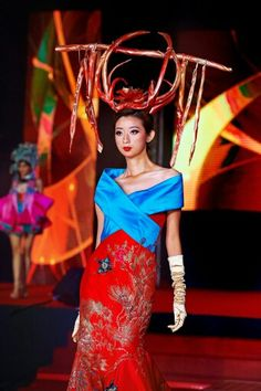 Fancy Goh wearing Bremen w millinery young prince's crown with butterfly wing motif from the Lao Han (Old Han) people of Guizhou (early Qing Dynasty ). For Carven Ong at SOGO KL 2014