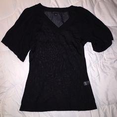 Banana Republic black top Viscose material. Sexy and classy! Banana Republic Tops Tees - Short Sleeve