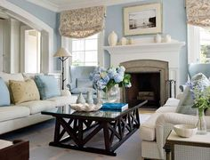 This room and its wonderful coloring is very special. The white, tan, and light blue everywhere else are grounded by the dark coffee table.