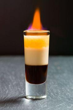 Flaming B-52 Cocktail—1 part Kahlua—1 Part Bailey's Irish Cream—1 Part Grand Marnier
