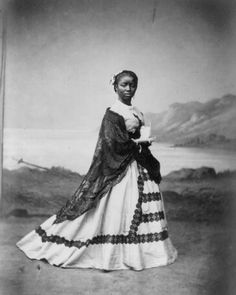 "This albumin print of a young Afro-Peruvian woman is in the Library of Congress and was taken in front of a painted landscape in a photo studio in Lima, Peru in 1868 by Courret Brothers, Photographers (Courret Hermanos Fotogs).  The woman's name was unfortunately not identified but her occupation as an ""Incense Burner"" was provided."