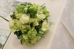 The Flower Magician:  Splendid Green Wedding Bouquet of Green Orchids, Jade Green Roses, Green Dianthus, Pale Green Hydrangeas, Lime Green Hypericum, Champagne Grass and Viburnum Opulus