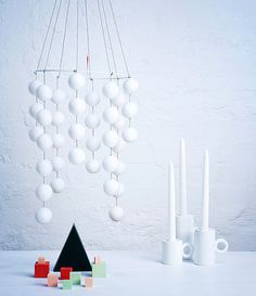 DIY Christmas decoration out of polystyrene balls. Kotivalo candle stick holders, design Eero Aarnio.